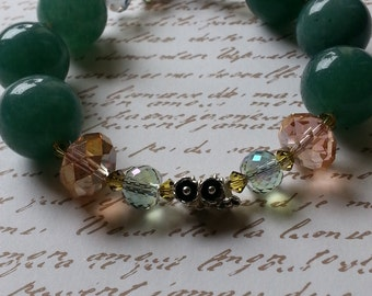 Aventurine bracelet with swarovski and tiny flower centerpieces.