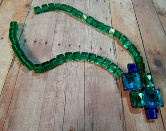 Statement necklace with blue, green pendant and green cube beads
