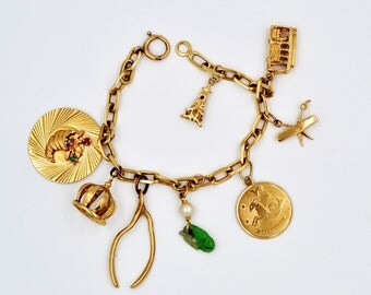 14K Gold Charm Bracelet, Pearl, Jade, Ruby Bracelet, verified by ind. graduate gemologist, 6.75''  Our original price 1077 now 945 dollars