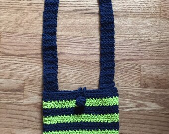 Navy blue and lime green striped handbag