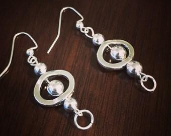 Metal beaded dangle earrings