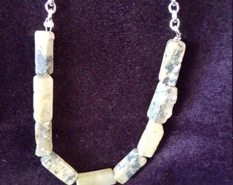 Yellow turquoise necklace with a 24 inch silver chain.