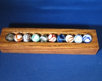Selection of Ten WV Swirl Marbles with Oak Display