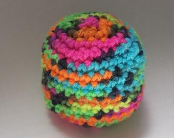 Neon hand crocheted hacky sack.