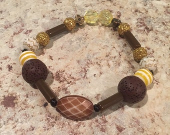Brown and yellow oil diffuser bracelet