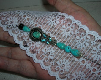 Turquoise glass beads and rhinestones make this Vintage hatpin dazzle