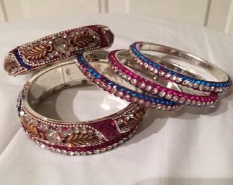 Custom-made bedazzled stack bracelets.