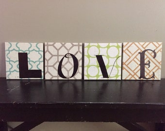 4 love canvases