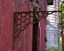 Ornate rusty shelving bracket