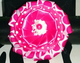 Pink polka dot flower hair bow