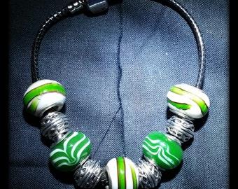 White, green, and black pandora like bracelet