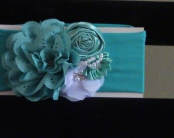 soft baby headband it fits 1 and 2 year old girls