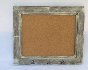 Brown Framed Cork Board With Clips