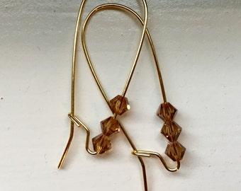 Tan crystal beaded gold loop earrings