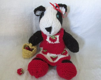 Hand knit badger with strawberry dress