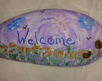 Decorative river rock doorstop
