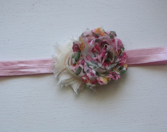 One Floral and one Ivory shabby flower on a light pink stretch headband. Baby/Toddler. Hair accessory.