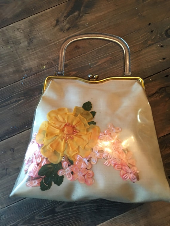 1950s Handbags, Purses, and Evening Bag Styles Vintage 1950s Clear Plastic/Vinyl Handbag $32.00 AT vintagedancer.com