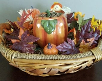 all silk flowers with light up pumpkin. Pumpkin light can be turned on or off.