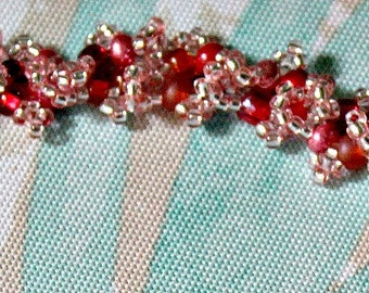 Vibrant red and pinks beaded bracelet
