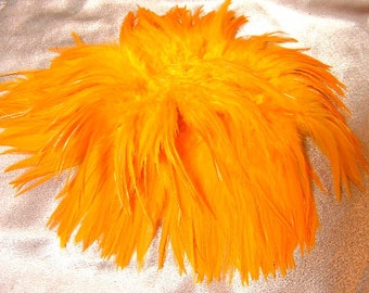 Golden yellow rooster feathers, saddle, hackle feathers, bulk, lot, wholesale, feather supply,