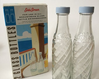 Two original boxed SodaStream bottles