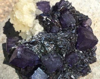 Dark purple fluorite w/ barite