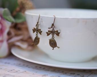 Cute Bronze Bird Hanging on a Bow Dangle Earrings
