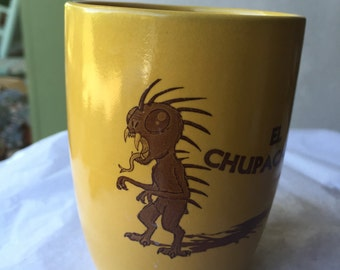 El Chupacabra Mustard Colored Porcelain Coffee Cup