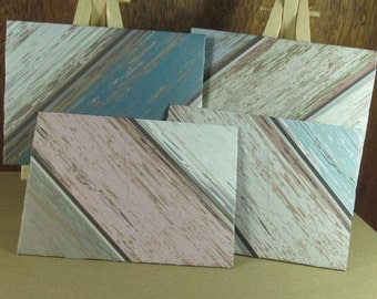 4 mini A7 Handmade envelopes in cream, pink and blue with weathered wood patterns, coloured inside