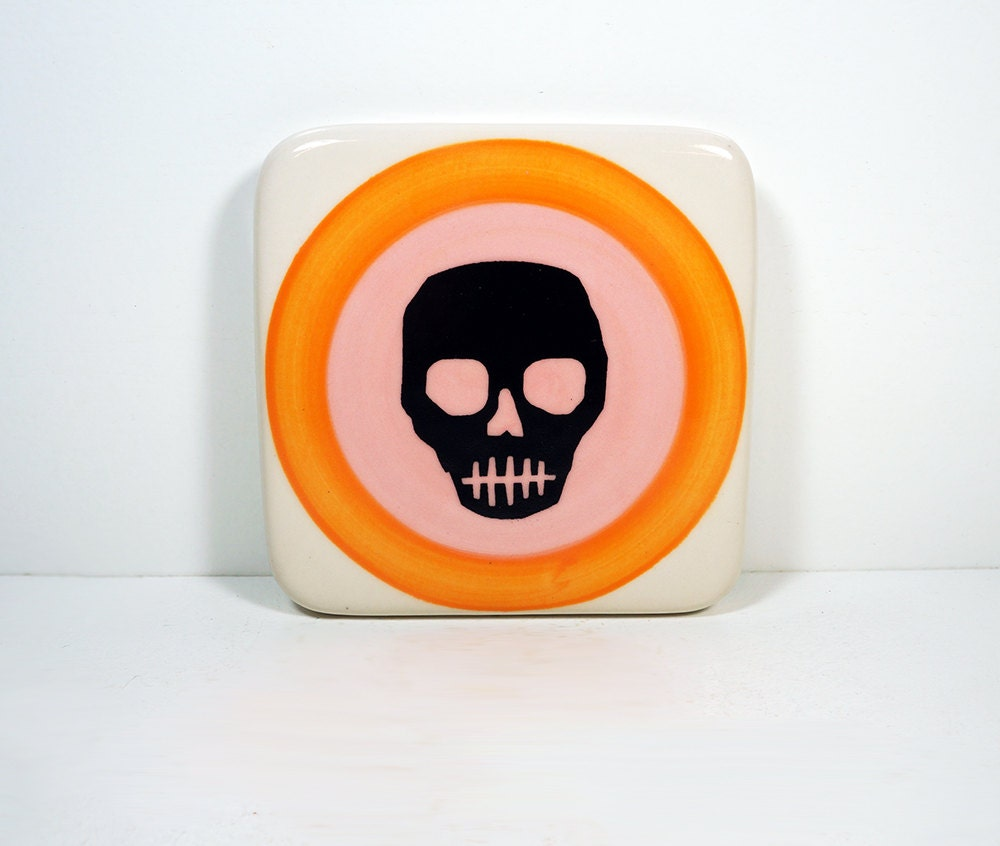 tile with voodoo skull on a colour block of orange and bubblegum pink. Made to Order.