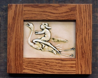 Framed Baby Riding a Stork -  limited edition handmade ceramic tile