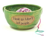 "Yarn bowl:  ""I knit so I don't kill people""  with two slots in green glaze"