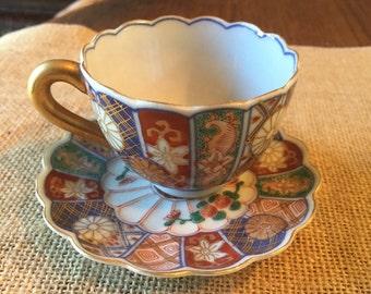Small antique Imari tea cup and saucer