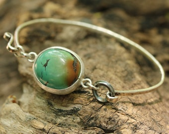 Oval turquoise with silver bangle bracelet