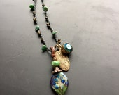 Handmade lampwork glass and bronze pendant charm necklace by Lori Lochner slate teal blue and bronze layering necklace artisan tribal rustic