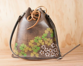 Drawstring Shoulder Bag - Leather Convertible Backpack in the Lucky Pattern with