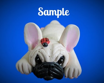 Light Creme Colored French Bulldog Dog on tummy with ladybug on head OOAK polymer clay art by Sally's Bits of Clay