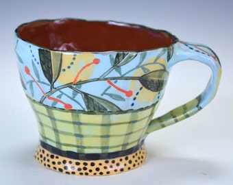 Cup, blue with plaid and leaf.