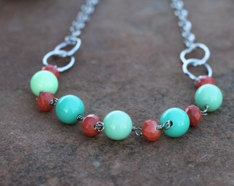 Long, wire wrapped, beautiful and unique necklace made with turquoise green and coral beads and silver link chain