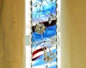 Bird on Art Glass.  Wire Composition.
