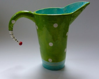 colorful pottery Pitcher / Lime green & light turquoise with polka-dots, embossed leaves, Beetlejuice striped handle