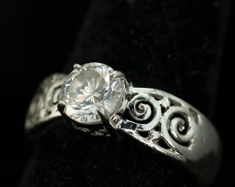 ON SALE Sterling Silver Ring with a Pierced Design and set with an 8mm Clear Faceted Crystal