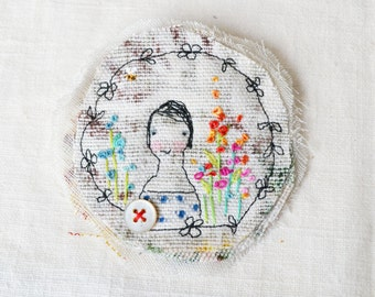 BROOCH Textile - free machine and hand embroidered.   In her garden.