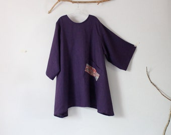 made to order linen tunic with large off-kilter rounded pocket