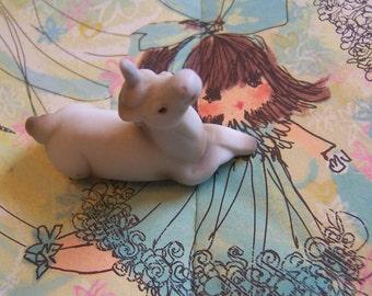 tiny little porcelain unicorn