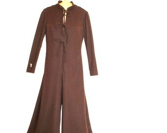 Classy vintage 70s dark chocolate brown polyester jumpsuit. Made by Jordan designer line. Size Medium.