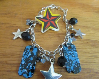 star themed charm bracelet and brooch