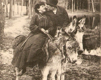 Vintage French Real Photo postcard, Romancing Lady and man riding donkey kissing, vintage postcard