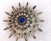 Vintage 1930s Art Deco Brooch Pin . 30s Blue and Clear Rhinestone Brooch . Silver Tone Pot Metal Star Pin